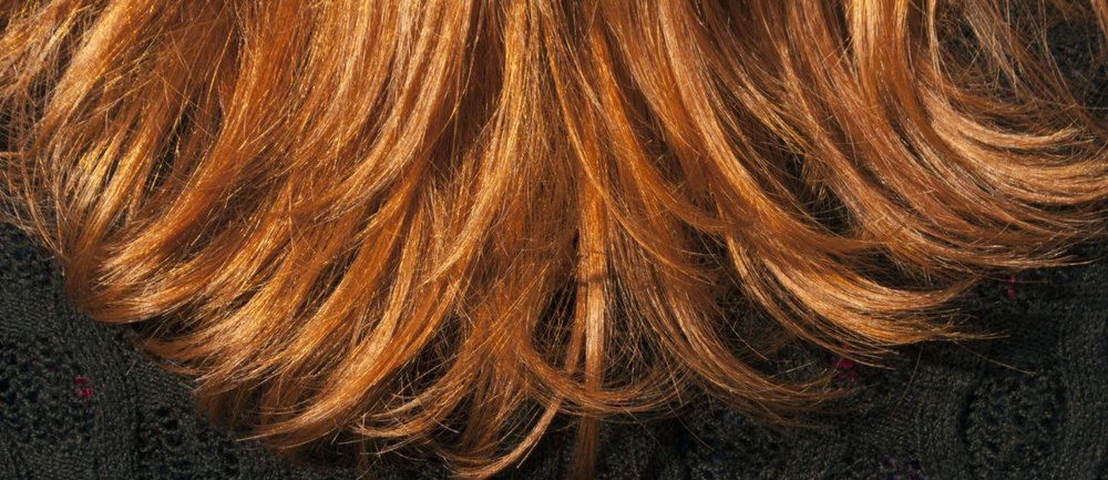 Red hair texture and black blouse. Background and texture