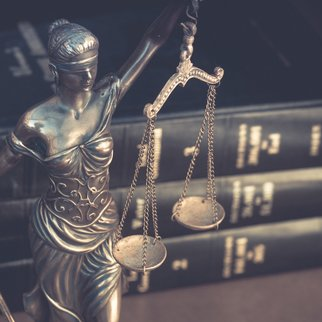 Legla law concept image, scales of justice and books