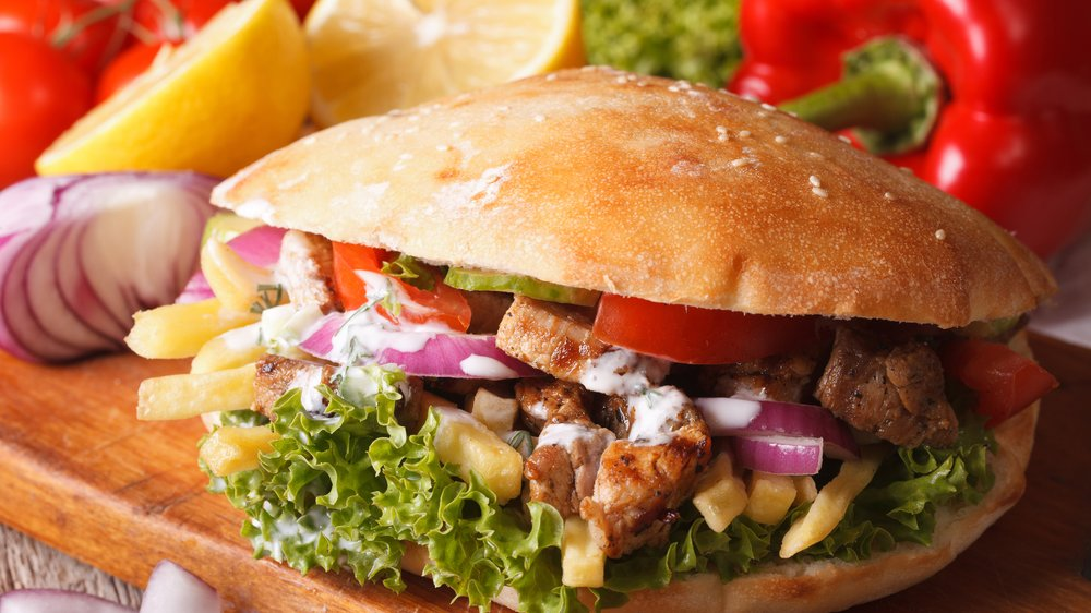 Doner kebab with meat and vegetables in pita bread closeup. horizontal