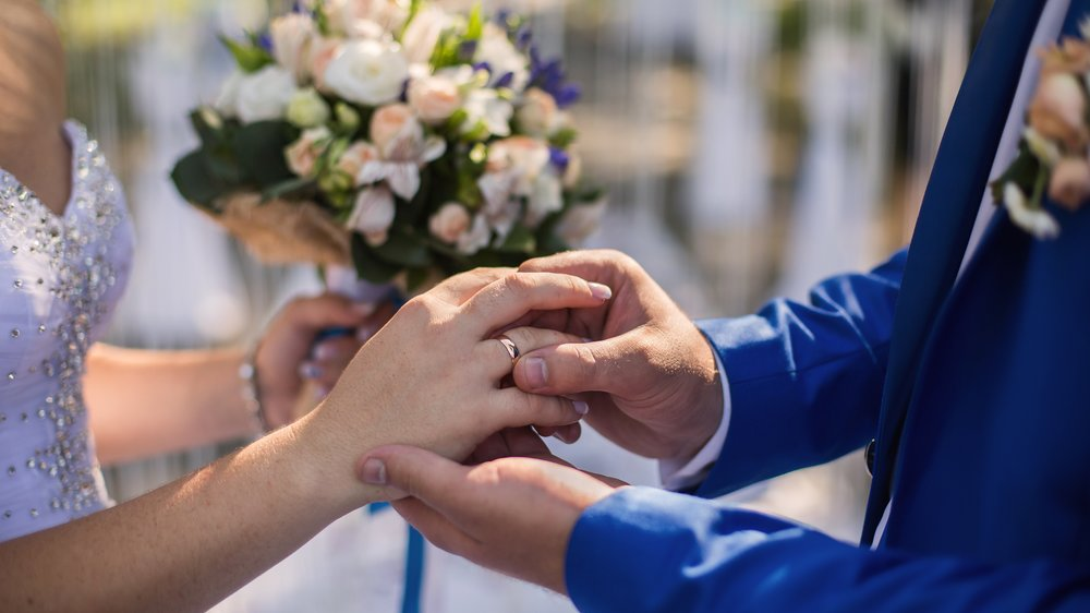 wedding rings on their hands, a ring on the finger, exchange rings, wedding ceremony
