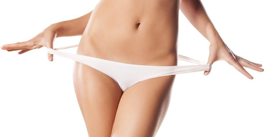 women pulls her elastic panties