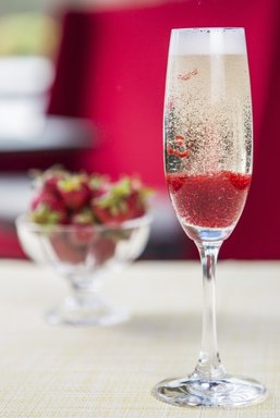 Glass of cold champagne with strawberries