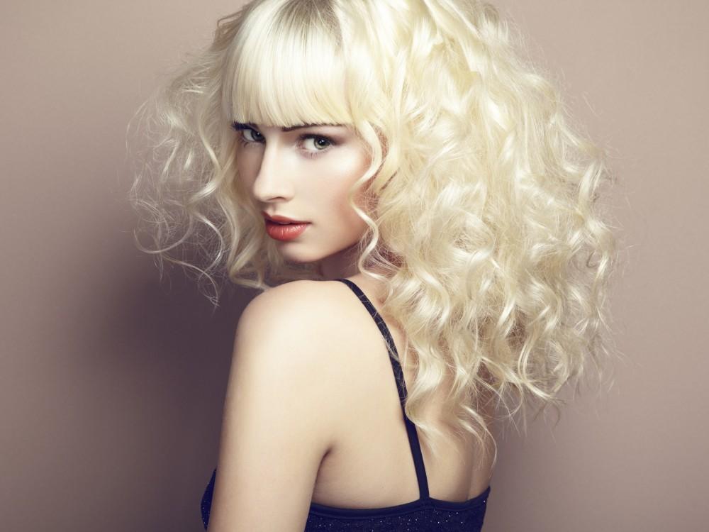 Portrait of beautiful young blonde girl. Fashion photo