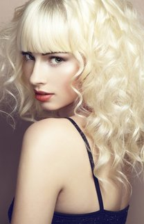 Portrait of beautiful young blonde girl. Fashion photo