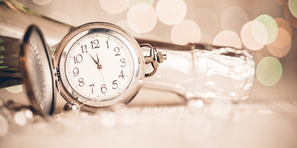 New Year's clock and champagne at midnight