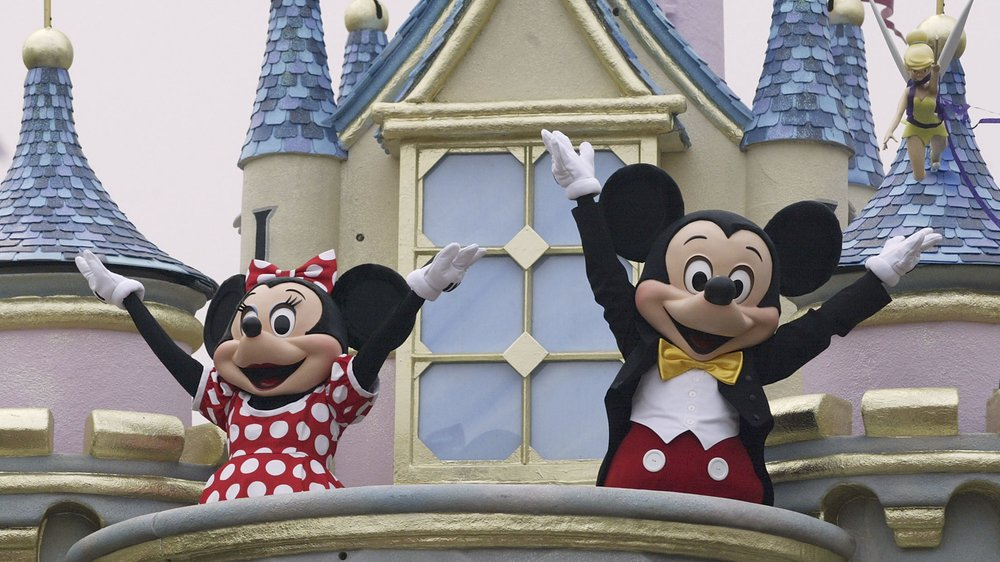 HONG KONG - SEPTEMBER 11: Disney characters Mickey Mouse and Minnie Mouse perform during the parade at Hong Kong Disneyland on September 11, 2005 in Hong Kong. The new theme park is scheduled to have its grand opening September 12. (Photo by MN Chan/Getty Images)