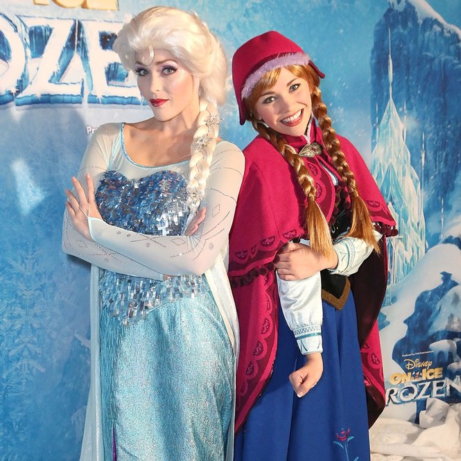 LOS ANGELES, CA - DECEMBER 10:  Elsa and Anna pose at Disney On Ice Presents Frozen Los Angeles Premiere at Staples Center on December 10, 2015 in Los Angeles, California.  (Photo by Ari Perilstein/Getty Images for Feld Entertainment)