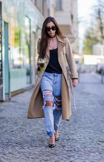 BERLIN, GERMANY - APRIL 22: Nadja Ali drinking a juice and wearing a beige Celine trench coat, a ripped denim jeans, a black top, black Celine sunglasses, black Saint Laurent heels on April 22, 2016 in Berlin, Germany. (Photo by Christian Vierig/Getty Images)