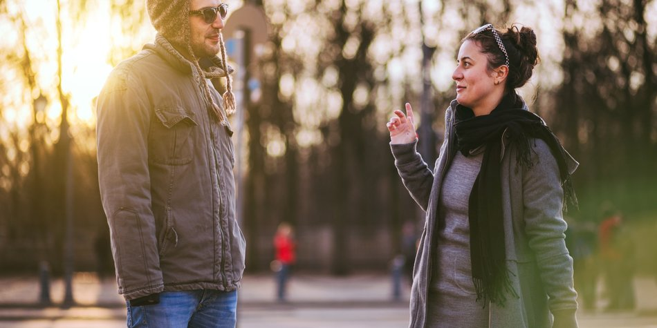 Young People Chatting Flirty In The Streets Of Berlin