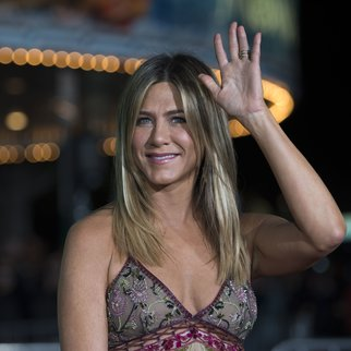 "Actress Jennifer Aniston arrives for the premiere of ""Office Christmas Party"" at the Regency Village Theater in Los Angeles on December 7, 2016. / AFP / VALERIE MACON (Photo credit should read VALERIE MACON/AFP/Getty Images)"