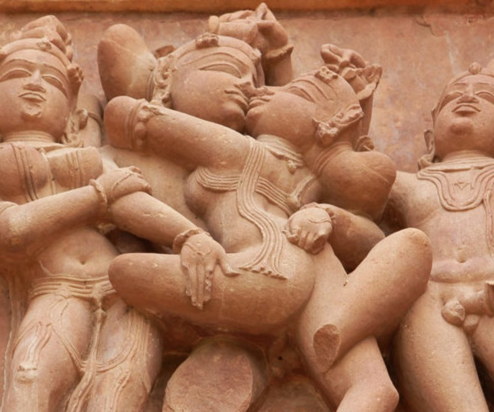 Stone carved erotic sculptures of tenth century in a Hindu temple in Khajuraho in Madhya Pradesh state of India. These temples (UNESCO heritage site) are famous and known to have all possible 64 sex positions sculpture.