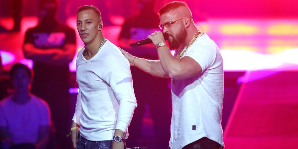 BERLIN, GERMANY - APRIL 12: 'Hip-Hop/Urban - National' award winners Farid Bang and Kollegah perform on stage during the Echo Award show at Messe Berlin on April 12, 2018 in Berlin, Germany. (Photo by Andreas Rentz/Getty Images)