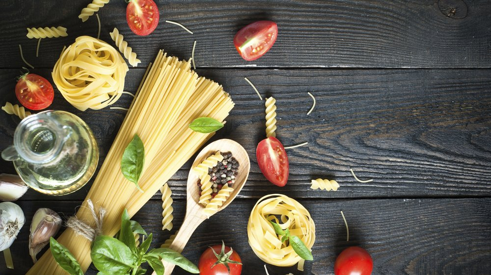 Ingredients for cooking Italian pasta - spaghetti, tomatoes, basil and garlic.