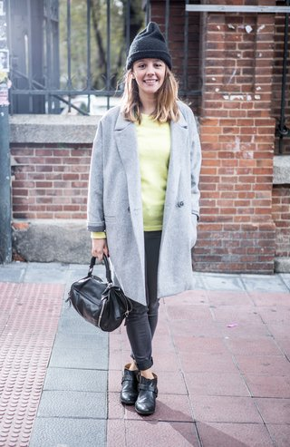 MADRID, SPAIN - NOVEMBER 10:  Cristina wears Zara trousers, shoes and handbag; American Vintage coat and pullover, and American Apparel cap during 'Mercado de Motores' at Ferrocarril museum on November 10, 2014 in Madrid, Spain.  (Photo by Pablo Cuadra/Getty Images)