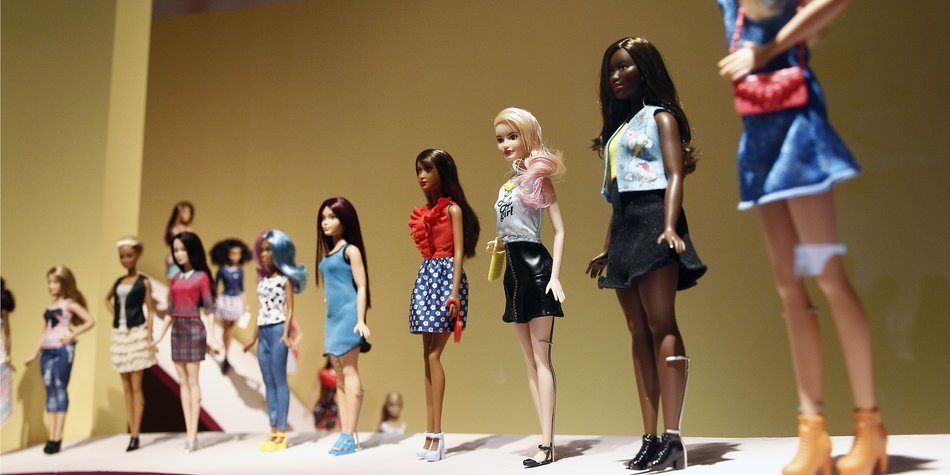 """PARIS, FRANCE - MARCH 09: Barbie dolls are displayed during the exhibition """"Barbie, life of an icon"""" at the Museum of Decorative Arts as part of the Paris Fashion Week Womenswear Fall/Winter 2016/2017 on March 9, 2016 in Paris, France. More than 700 Barbie dolls are displayed during the exhibition which takes place from March 10 to September 18, 2016. (Photo by Thierry Chesnot/Getty Images)"""