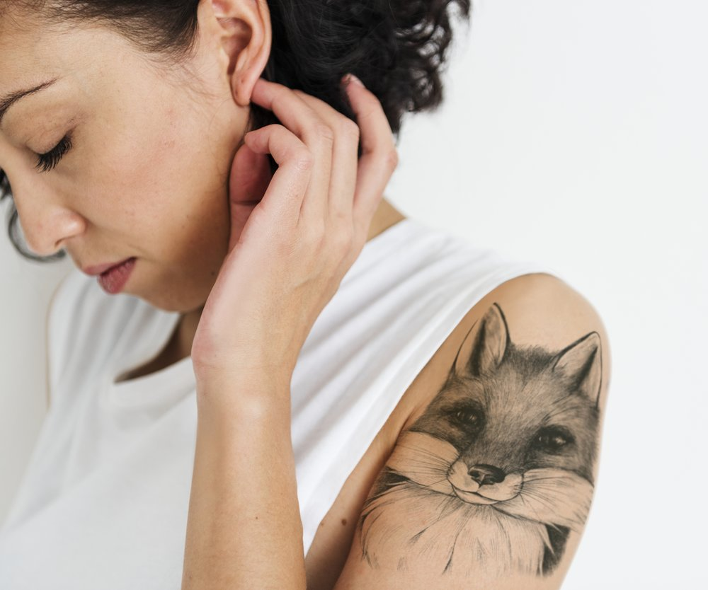 Portrait of an emotional woman with a tattoo