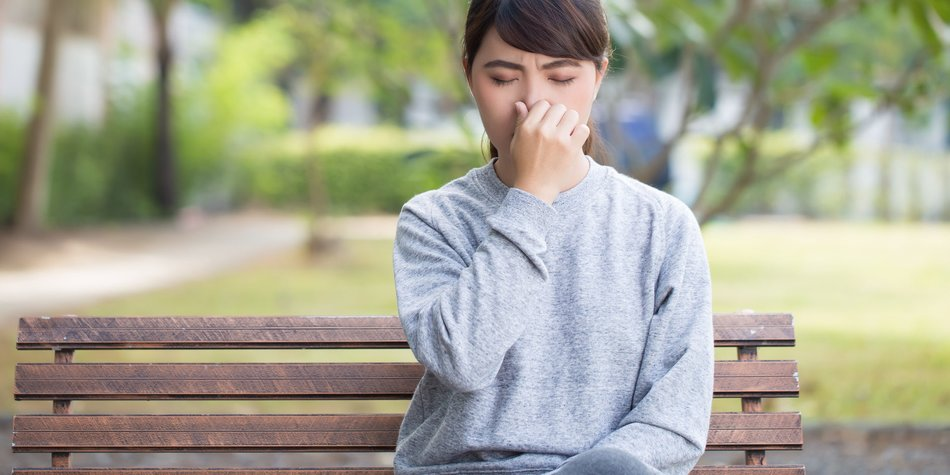 Woman has sneezing at park