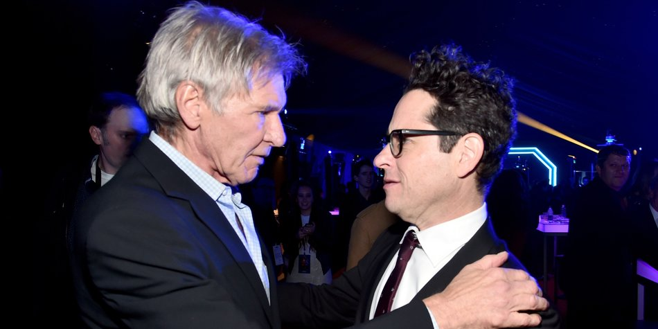 "HOLLYWOOD, CA - DECEMBER 14: Actor Harrison Ford (L) and director J.J. Abrams attend the after party for the World Premiere of ""Star Wars: The Force Awakens"" on Hollywood Blvd on December 14, 2015 in Hollywood, California. (Photo by Alberto E. Rodriguez/Getty Images for Disney)"