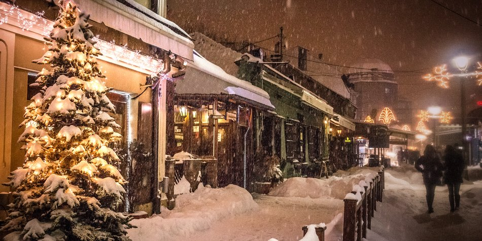 Peaceful European street on the Christmass eve during winterstorm