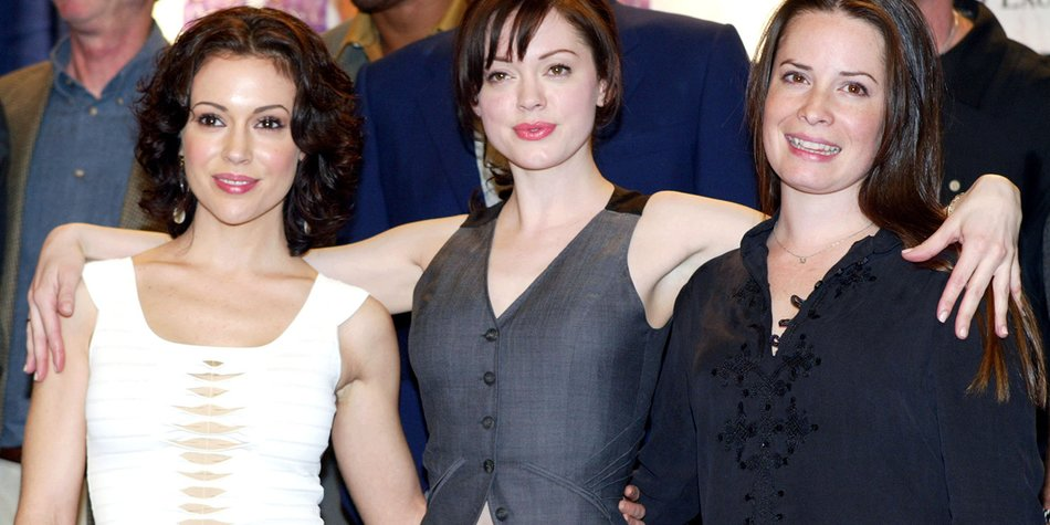 """LOS ANGELES - FEBRUARY 1: (from left to right) Actresses Alyssa Milano, Rose McGowan and Holly Marie Combs celebrate the WB's """"Charmed"""" 150th episode cake cutting on the set at Paramount Studios on February 1, 2005 in Los Angeles, California. (Photo by Kevin Winter/Getty Images)"""