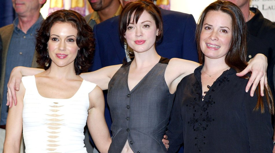 "LOS ANGELES - FEBRUARY 1: (from left to right) Actresses Alyssa Milano, Rose McGowan and Holly Marie Combs celebrate the WB's ""Charmed"" 150th episode cake cutting on the set at Paramount Studios on February 1, 2005 in Los Angeles, California. (Photo by Kevin Winter/Getty Images)"
