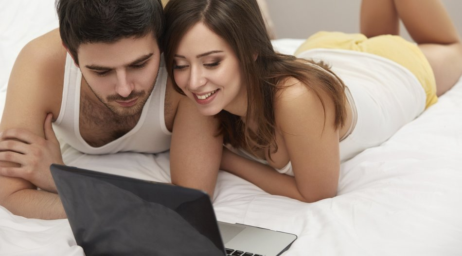 Couple on Bed with laptop