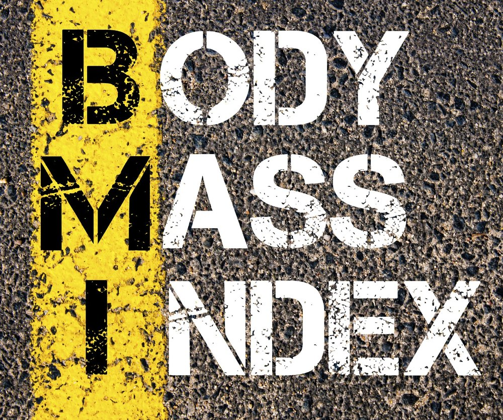 Acronym BMI - Body Mass Index. Conceptual image with yellow paint line on the road over asphalt stone background.