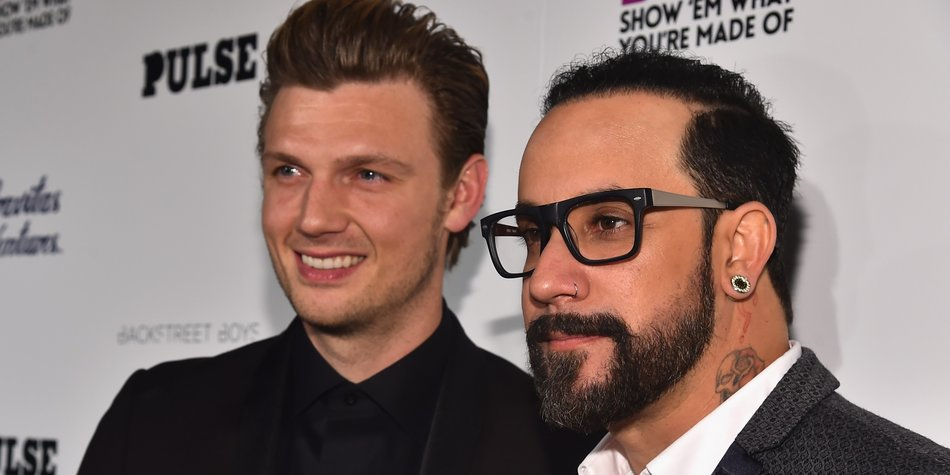 "HOLLYWOOD, CA - JANUARY 29: Singers Nick Carter and A.J. McLean attend the premiere of Gravitas Ventures' ""Backstreet Boys: Show 'Em What You're Made Of"" at on January 29, 2015 in Hollywood, California. (Photo by Alberto E. Rodriguez/Getty Images)"