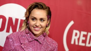 NEW YORK, NY - DECEMBER 01: Singer-songwriter Miley Cyrus attends the ONE Campaign and (RED)'s concert to mark World AIDS Day, celebrate the incredible progress that's been made in the fights against extreme poverty and HIV/AIDS, and to honor the extraordinary leaders, dedicated activists, and passionate partners who have made that progress possible. At Carnegie Hall on December 1, 2015 in New York City. (Photo by Dave Kotinsky/Getty Images for The ONE Campaign)