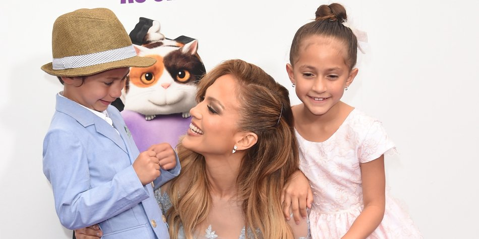 """WESTWOOD, CA - MARCH 22: Jennifer Lopez (C) with daughter Emme (R) and son Max attend the premiere of Twentieth Century Fox And Dreamworks Animation's """"HOME"""" at Regency Village Theatre on March 22, 2015 in Westwood, California. (Photo by Jason Merritt/Getty Images)"""