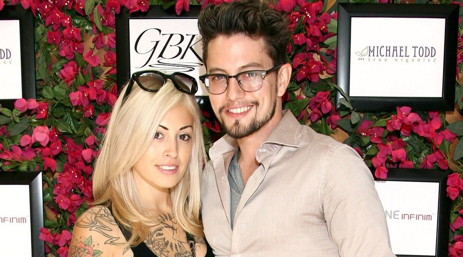 BEVERLY HILLS, CA - AUGUST 23: Actor Jackson Rathbone (R) and Sheila Hafsadi attend the GBK Productions Luxury Lounge honoring the best in TV held at LErmitage on August 23, 2014 in Beverly Hills, California. (Photo by Tommaso Boddi/Getty Images for GBK Productions)