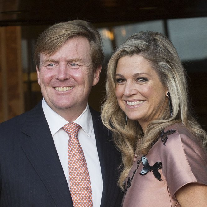 AMSTERDAM, NETHERLANDS - SEPTEMBER 26: King Willem-Alexander of The Netherlands (L) and Queen Maxima of The Netherlands (wearing a dress by Flemish designer Natan) arrive for festivities marking the final celebrations of 200 years Kingdom of The Netherlands on September 26, 2015 in Amsterdam, Netherlands (Photo by Michel Porro/Getty Images)
