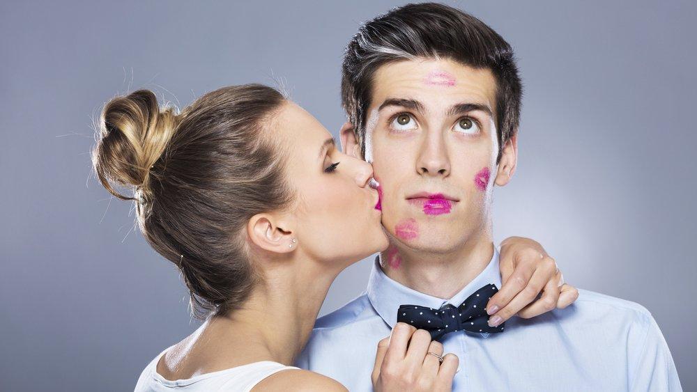 Young woman kissing man