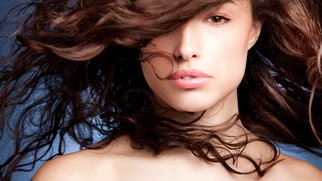 young woman portrait with long wild hair