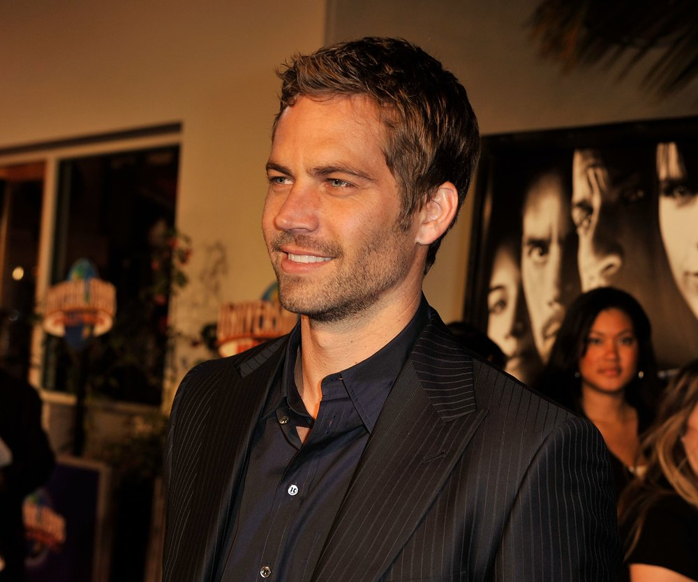 """UNIVERSAL CITY, CA - MARCH 12: Actor Paul Walker arrives at the premiere Universal's """"Fast & Furious"""" held at Universal CityWalk Theaters on March 12, 2009 in Universal City, California. (Photo by Kevin Winter/Getty Images)"""