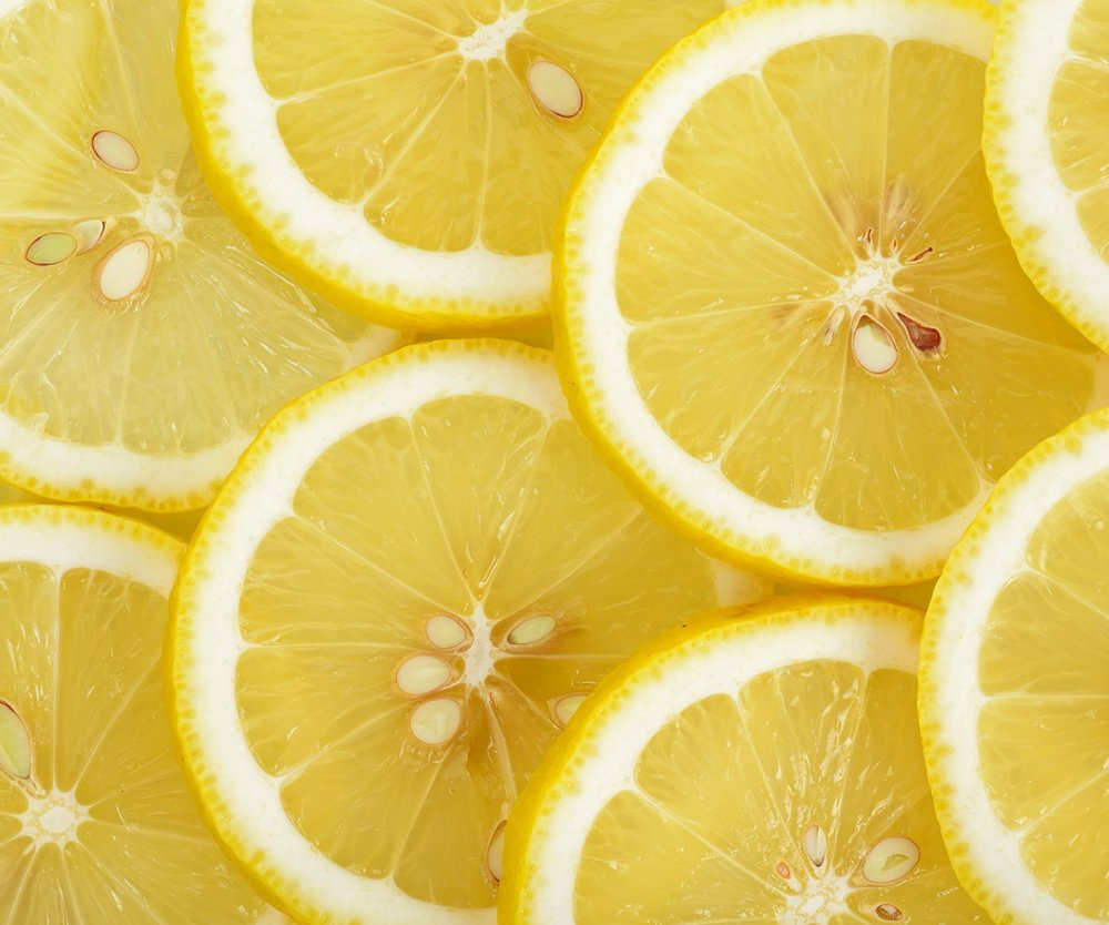 Close up sliced yellow lemon background texture.