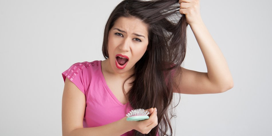 woman concerned about the condition of the hair