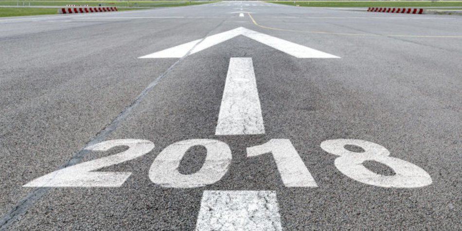 Runway of airport with arrow guideline and year 2018 letters painted on the surface