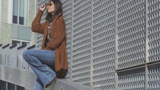Beautiful girl with long hair posing in an urban context