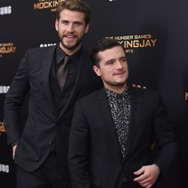 "NEW YORK, NY - NOVEMBER 18:  Liam Hemsworth (L) and Josh Hutcherson attend ""The Hunger Games: Mockingjay- Part 2"" New York Premiere at AMC Loews Lincoln Square 13 theater on November 18, 2015 in New York City.  (Photo by Jamie McCarthy/Getty Images)"