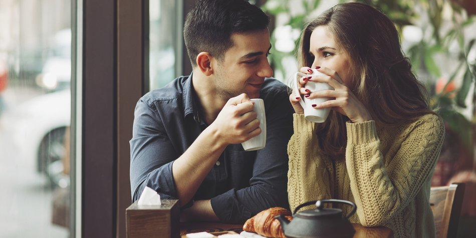Couple in love drinking coffee and have fun in coffee shop. Love concepts. Vintage effect style picture