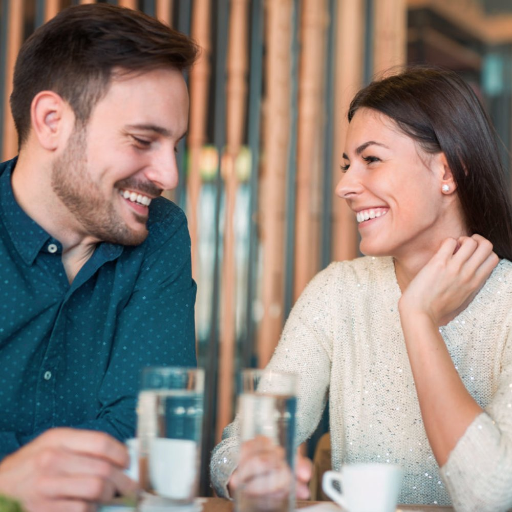 Handsome loving couple flirting in a cafe. Love and romance. Lifestyle concept