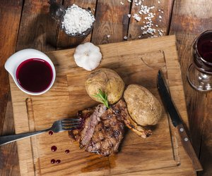 Steak with spices, thyme and chili served on a cutting board