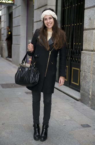 MADRID, SPAIN - DECEMBER 17: Eva wearing Zara shoes, H&M Trousers, Gerard Darel handbag and coat on December 17, 2014 in Madrid, Spain. (Photo by Juan Naharro Gimenez/Getty Images)