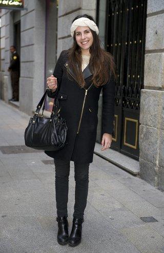 MADRID, SPAIN - DECEMBER 17:  Eva wearing Zara shoes, H&M Trousers, Gerard Darel handbag and coat on December 17, 2014 in Madrid, Spain.  (Photo by Juan Naharro Gimenez/Getty Images)