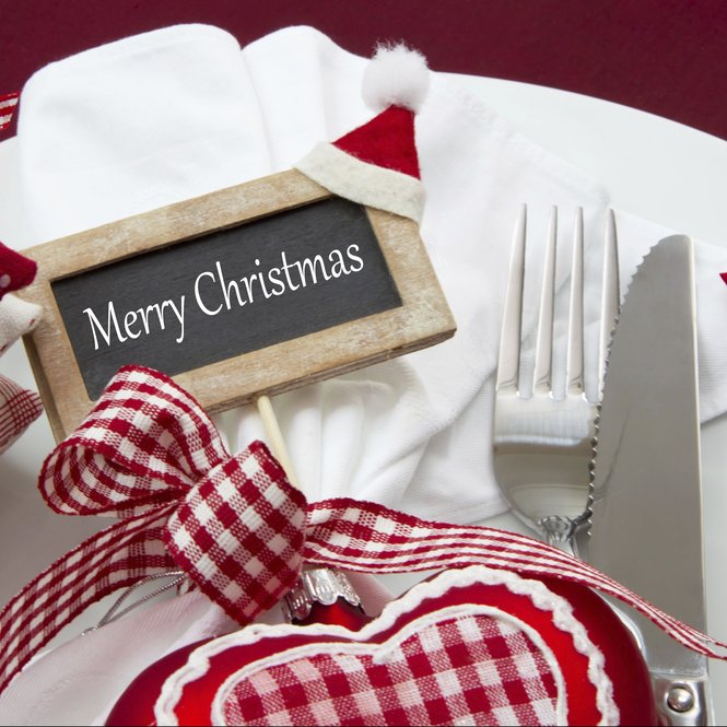 Decoration of christmas tableware - fork and knife in red