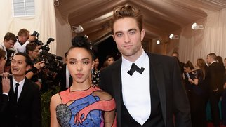 """NEW YORK, NY - MAY 04: Robert Pattinson (R) and FKA Twigs attend the """"China: Through The Looking Glass"""" Costume Institute Benefit Gala at the Metropolitan Museum of Art on May 4, 2015 in New York City. (Photo by Larry Busacca/Getty Images)"""