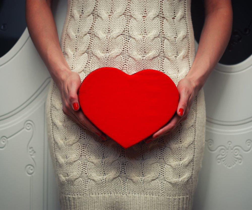 female hand holding object shape heart concept