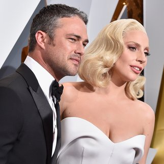 HOLLYWOOD, CA - FEBRUARY 28: Recording artist Lady Gaga (R) and actor Taylor Kinney attend the 88th Annual Academy Awards at Hollywood & Highland Center on February 28, 2016 in Hollywood, California. (Photo by Kevork Djansezian/Getty Images)