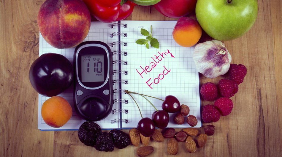 Vintage photo, Fresh fruits, vegetables and glucose meter on notebook for writing notes, concept of healthy nutrition, diet and diabetes, sugar level